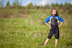 Portrait of little girl in wetsuit Stock Photos