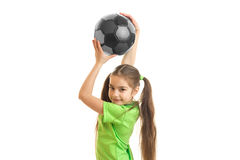 Portrait of a little girl which is raised above the head soccer ball Royalty Free Stock Photo