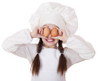 Portrait of a little girl in a white apron holding two chicken e Stock Photo