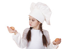 Portrait of a little girl in a white apron holding two chicken e Stock Images
