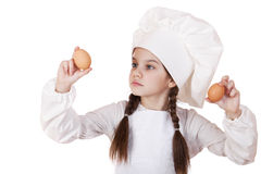 Portrait of a little girl in a white apron holding two chicken e Stock Image