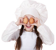 Portrait of a little girl in a white apron holding two chicken e Royalty Free Stock Images