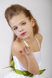 Portrait of a little girl in white classic dress Stock Photos