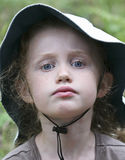 A Portrait of a Little Girl in a White Hat Stock Images