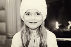 Portrait of little girl in white hat by fireplace Royalty Free Stock Photography