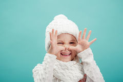 Portrait of a little  girl in white hat and scarf Royalty Free Stock Image