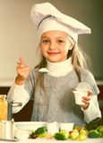 Portrait of little girl with white sour cream indoors Stock Photos