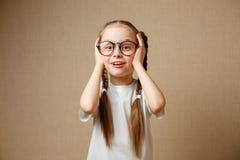 Cute schoolgirl in glasses royalty free stock photos