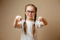 Cute schoolgirl in glasses stock photo