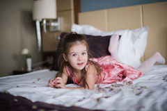 Portrait of a little girl who played on the bed in the bedroom Royalty Free Stock Photo