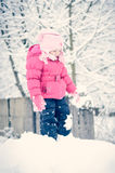 Portrait of a little girl in winter clothes having fun in the sn Royalty Free Stock Photos