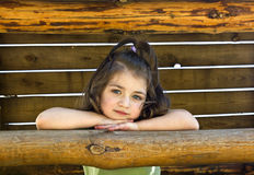 Portrait of little girl on the wooden background Royalty Free Stock Image