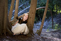 Portrait of a little girl in the woods Stock Images