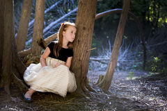 Portrait of a little girl in the woods Stock Photo
