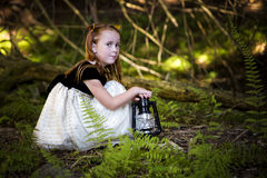 Portrait of a little girl in the woods Royalty Free Stock Photos