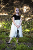 Portrait of a little girl in the woods Royalty Free Stock Photography