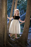 Portrait of a little girl in the woods Stock Photos
