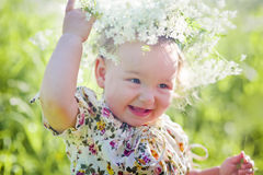 Portrait of little girl with wreath Stock Image