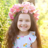 Portrait of little girl in wreath with flowers Royalty Free Stock Images