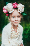 Portrait of a little girl with wreath of peony flowers Royalty Free Stock Images