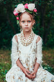 Portrait of a little girl with wreath of peony flowers Royalty Free Stock Photography