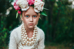 Portrait of a little girl with wreath of peony flowers Stock Photo