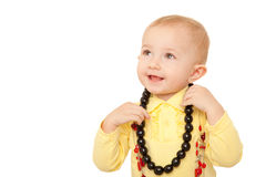 Portrait of little girl in yellow shirt with beads Stock Image
