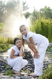 Portrait of little girls. Around the fountain Stock Photography
