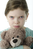 Portrait of  little girls cry holding teddy bear on white Royalty Free Stock Image
