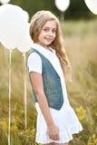 Portrait of a little girls in a field Stock Image