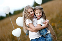 Portrait of a little girls in a field Stock Photos