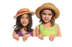 Portrait of little girls holding a sign stock photos