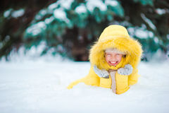 Portrait of little happy adorable girl in snow sunny winter day Stock Image
