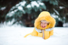 Portrait of little happy adorable girl in snow sunny winter day Royalty Free Stock Images