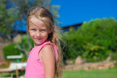 Portrait of little happy beautiful girl outdoors Stock Photos