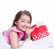Portrait of little happy girl with a gift. Royalty Free Stock Images