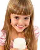 Portrait of a little happy girl with a glass of yogurt. Royalty Free Stock Image