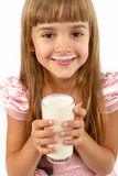 Portrait of a little happy girl with a glass of yogurt.