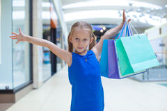 Portrait of little happy girl holding shopping Stock Photos