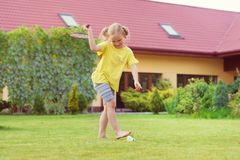 Portrait of little happy girl playing barefoot badminton at gard Royalty Free Stock Photos