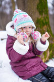 Portrait of little happy girl in the snow sunny Royalty Free Stock Image