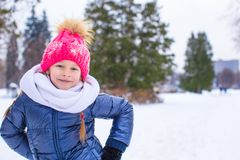 Portrait of little happy girl in the snow sunny Stock Photo