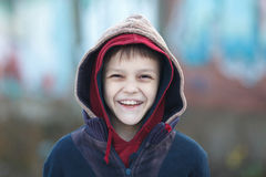 Portrait of a little happy homeless boy Royalty Free Stock Image