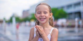 Portrait of little happy wet girl outdoors Stock Photos