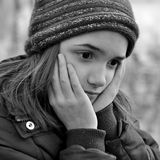 Monochrome Portrait of Sad Girl Stock Images