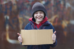 Portrait of a little homeless boy. Portrait of a little happy homeless boy Stock Photos