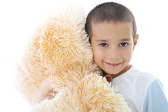 Portrait of a little kid hugging his toy. Portrait of a little kid with bear toy isolated in white stock image