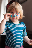 Portrait of little kid with toy glasses Stock Photo