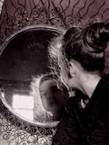 Portrait of little lady at the antique mirror. Portrait of little lady at the mirror royalty free stock photo