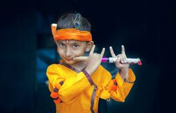 Portrait of little lord Krishna Kanhaiya Boy Child royalty free stock image